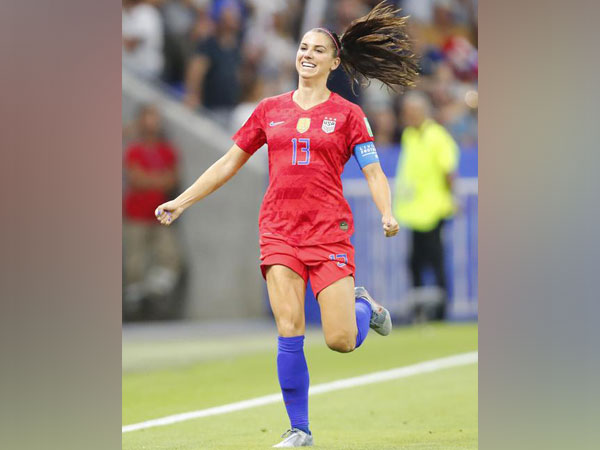 United States forward Alex Morgan celebrates after scoring a goal against England in the first half of semi-final play in the FIFA Women's World Cup