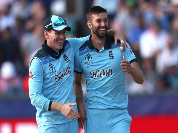 England skipper Eoin Morgan (left) with pacer Mark Wood (right)