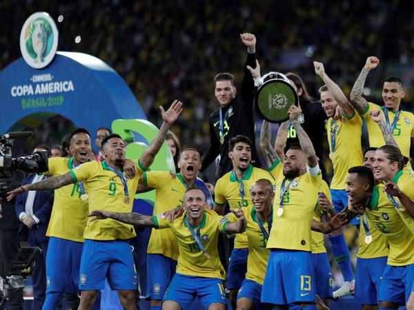 Brazil football team with the 2019 Copa America trophy after defeating Peru by 3-1 at Maracana Stadium in Rio de Janeiro on Sunday.