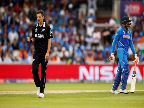 New Zealand's Trent Boult celebrates the wicket of India's Ravindra Jadeja