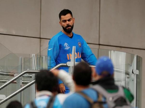 Dejected Virat Kohli after New Zealand beat India