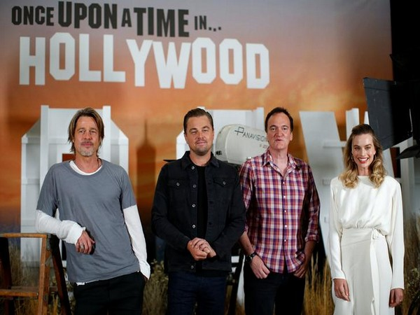 Brad Pitt, Leonardo di Caprio, director Quentin Tarantino, and Margot Robbie pose for a picture during 'Once Upon a Time in Hollywood' promotion