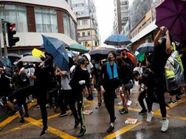 Protesters carrying umbrellas while marching in Hung Hom as part of the months-long anti-government protests in Hong Kong on Saturday.