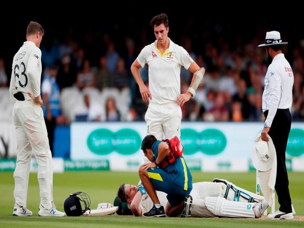 ustralia's Steve Smith receives treatment as he lays on the floor after being hit by a ball from England's Jofra Archer