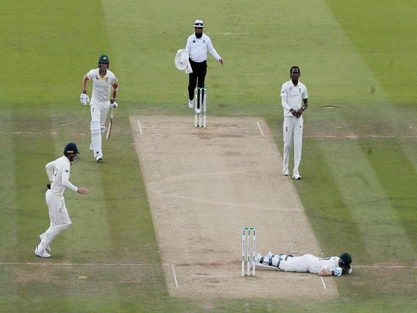 Australia's Steve Smith lays on the floor after being hit by a ball from England's Jofra Archer