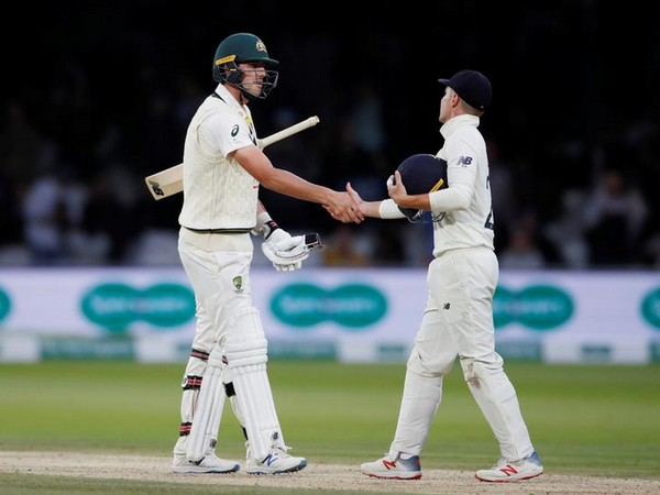 Australia's Pat Cummins and England's Rory Burns shake hands at the end of play as the second test ends in a draw