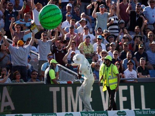 England's Jofra Archer throws an inflatable watermelon towards fans during the match