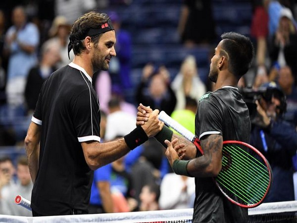 Roger Federer shaking hands with Sumit Nagal after the first round match of US Open.