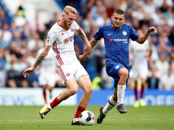 Sheffield United's Oliver McBurnie in action with Chelsea's Mateo Kovacic