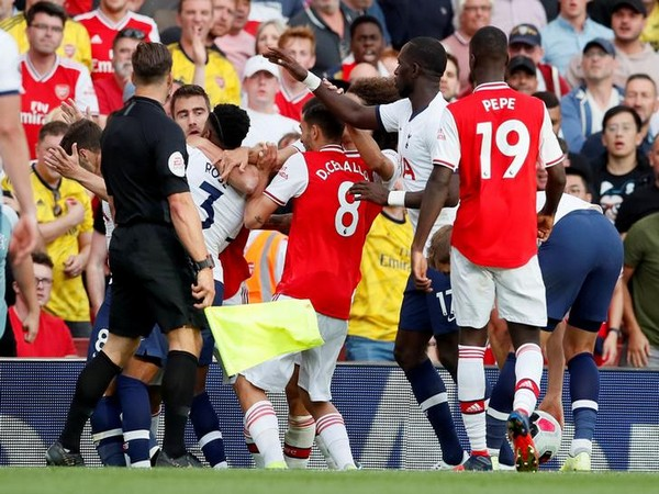 Tottenham Hotspur's Danny Rose clashes with Arsenal's Sokratis Papastathopoulos
