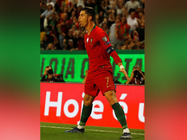 Portugal's Cristiano Ronaldo celebrates after scoring goal against Luxembourg