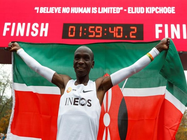 Kenya's Eliud Kipchoge, the marathon world record holder, celebrates after a successful attempt to run a marathon in under two hours in Vienna