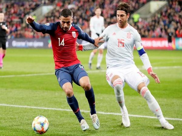 Spain's Sergio Ramos (right)