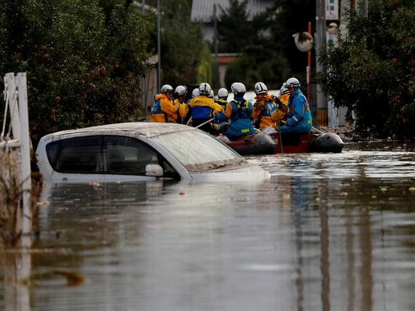 Rescue workers search a flooded area in the aftermath of Typhoon Hagibis, which caused severe floods at the Chikuma River in Nagano, Japan. Photo/ANI