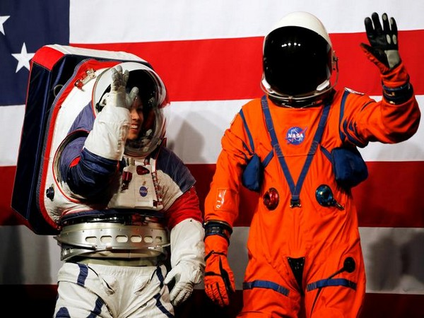 NASA engineer Dustin Gohmert (right) in the Orion Crew survival suit, with Advanced Space Suit Engineer Kristine Davis in the moon suit. Photo/ANI