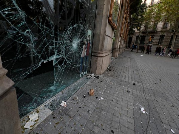 A shop window is shattered during clashes in Catalonia's general strike in Barcelona