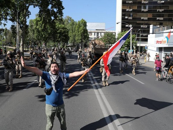 A protester waves a flag during a protest  in Santiago, Chile