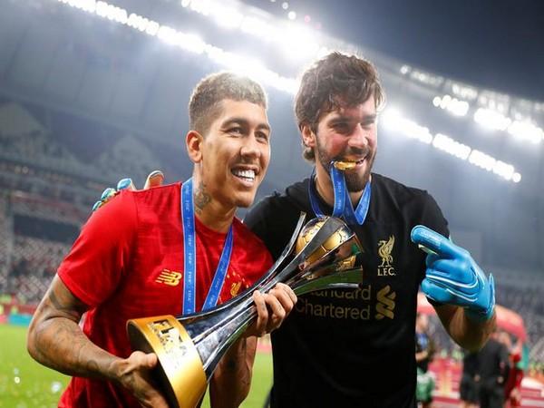 Liverpool's Roberto Firmino and Alisson Becker