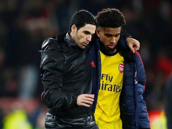 Arsenal manager Mikel Arteta with Reiss Nelson