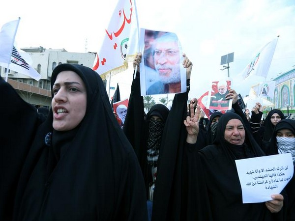 Mourners gather ahead of the funeral of Iranian Major-General Qassem Soleimani in Karbala.