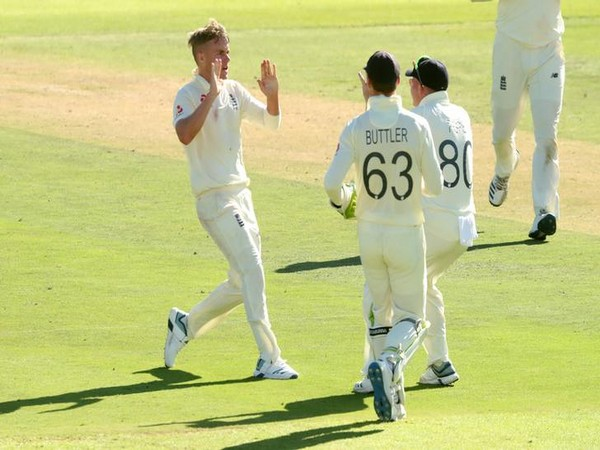 England's Sam Curran celebrates after taking the wicket of South Africa's Rassie van der Dussen with Ollie Pope and Jos Buttler.
