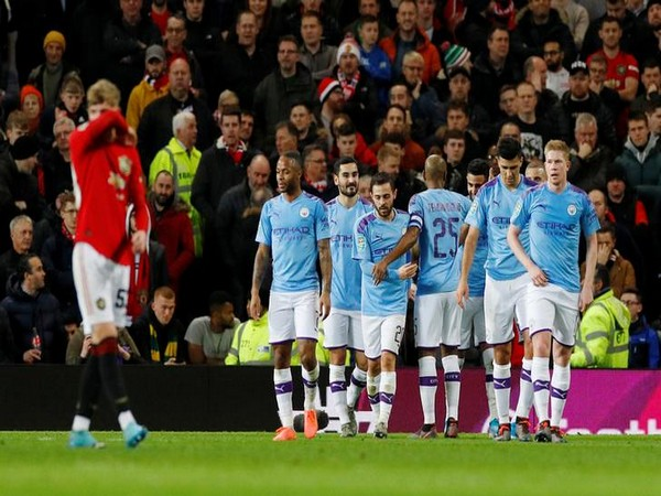 Manchester City's Riyad Mahrez celebrates scoring their second goal with teammates against Manchester United