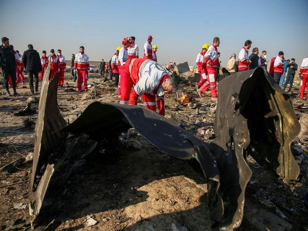 Red Crescent workers check the debris from the Ukraine International Airlines plane, that crashed after take-off from Iran's Imam Khomeini airport, on the outskirts of Tehran, Iran January 8, 2020