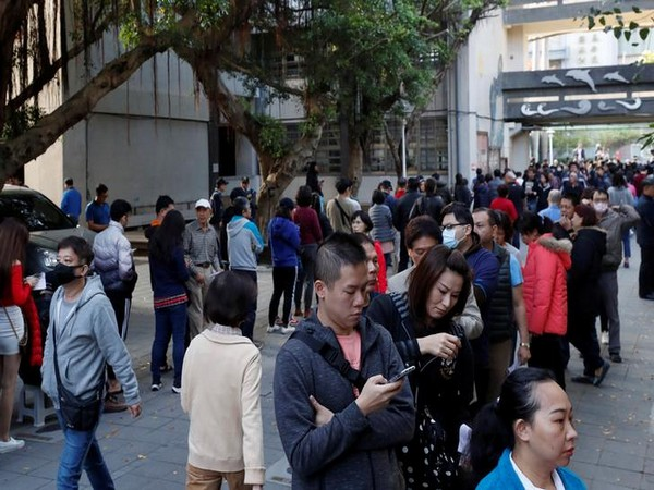 People line up at a polling station during general elections in New Taipei City, Taipei, Taiwan