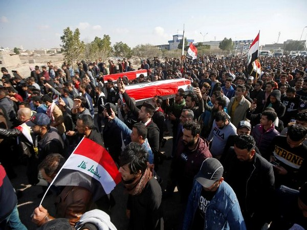 Mourners carry mock coffins for Ahmed Abdulsamad and Safa Ghali, local journalists at Dijla TV station, who were killed by gunmen as they were covering protests in Basra