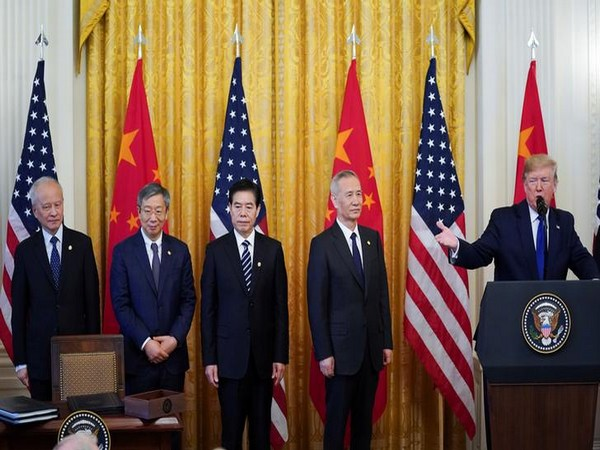 Chinese Vice Premier Liu He and his team listen as US President Donald Trump speaks at the start of the deal signing ceremony for 'Phase One' of US-China trade agreement.