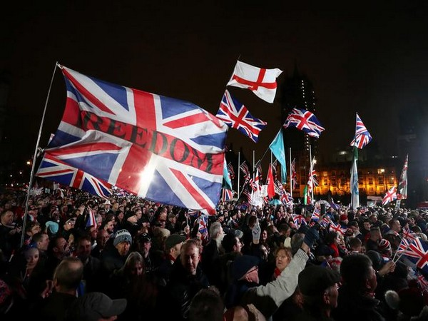 Pro-Brexit demonstrators celebrate on Parliament Square on Brexit day in London.
