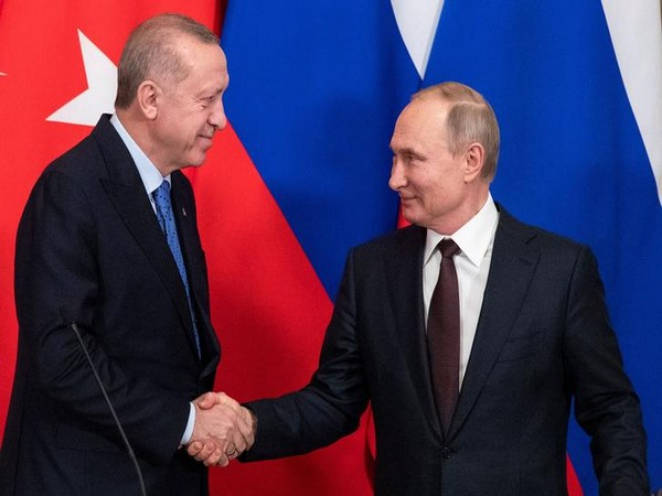 Russian President Vladimir Putin and Turkish President Tayyip Erdogan shake hands during a news conference following their talks in Moscow.