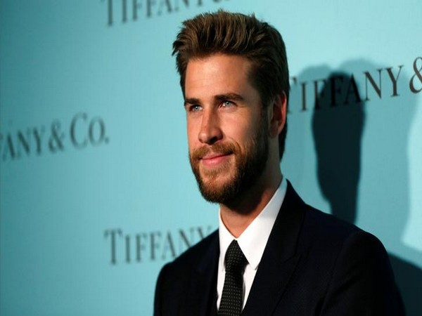 Liam Hemsworth poses at a reception for the re-opening of the Tiffany & Co. store in Beverly Hills