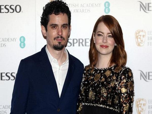 Director Damien Chazelle and actress Emma Stone pose for photographers at the British Academy Film Awards