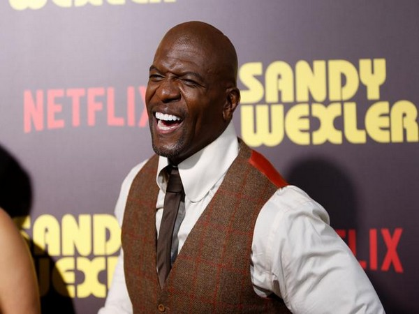 Actor Terry Crews posing at a premiere for the Netflix original film 'Sandy Wexler'