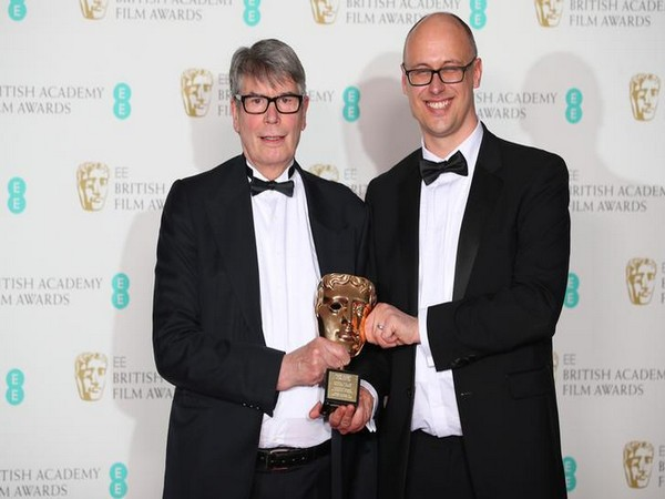 Nik Powell (L) and Jon Wardle hold award for Outstanding Contribution to British Cinema at the British Academy of Film and Television Awards in London
