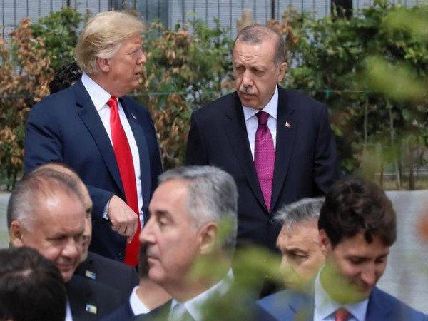 U.S. President Donald Trump, Turkish President Tayyip Erdogan and Canada's Prime Minister Justin Trudeau are seen at the start of the NATO summit in Brussels, Belgium