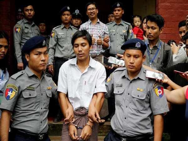 Detained Reuters journalist Kyaw Soe Oo and Wa Lone escorted by Myanmar police (Picture Credits: Reuters)