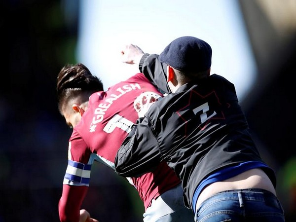 Fan invading the pitch and assaulting Aston Villa's captain Jack Grealish