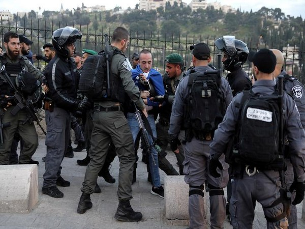 A Palestinian demonstrator detained by Israeli police in Al-Aqsa mosque in East Jerusalem.