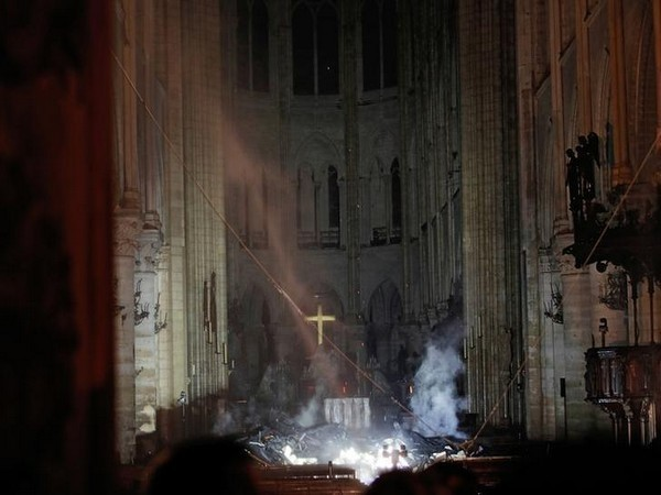 A file picture of smoke erupting from Notre Dame Cathedral