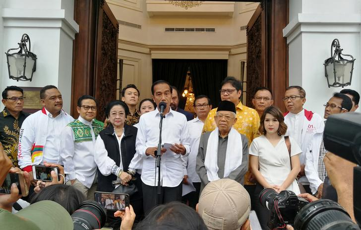 President Joko Widodo talks to reporters about the results of the Presidential elections in Indonesia