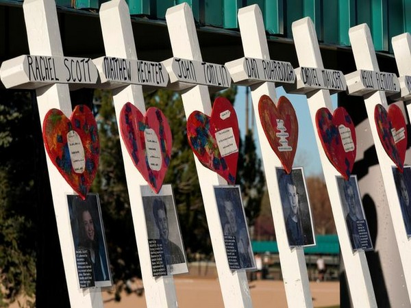 A line of crosses commemorating some of those killed are displayed near the Columbine memorial a day before the school shootings' 20th anniversary in Littleton, Colorado