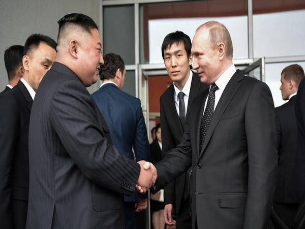 Russia's President Vladimir Putin (R) shakes hands with North Korea's leader Kim Jong Un (Reuters)