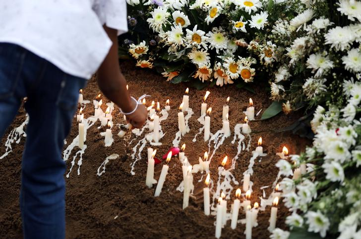 Candles burn at the funeral of Dhami Brindya, 13, victim of a string of suicide bomb attacks on churches and luxury hotels on Easter Sunday, in Negombo, Sri Lanka