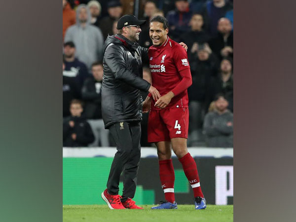 Liverpool player Virgin van Dijk with manager Jurgen Klopp