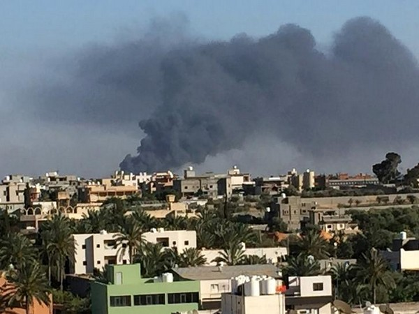 Smoke rises during a fight between members of the Libyan internationally recognised government forces and LNA (Reuters)