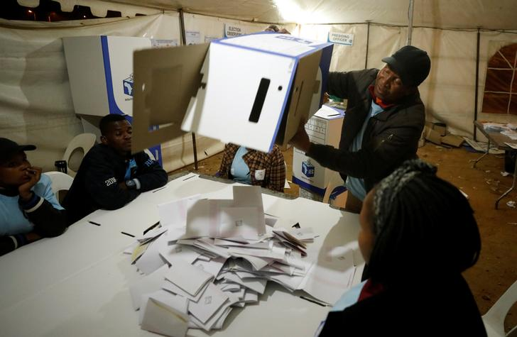A South African election official empties a ballot box during vote counting in Johannesburg on Friday.