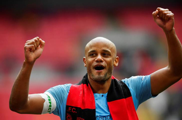 Manchester City's Vincent Kompany celebrates after winning the FA Cup