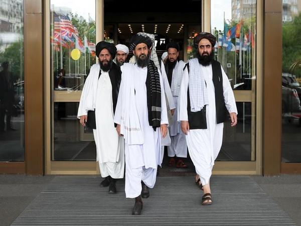 Members of a Taliban delegation, led by chief negotiator Mullah Abdul Ghani Baradar (C front)